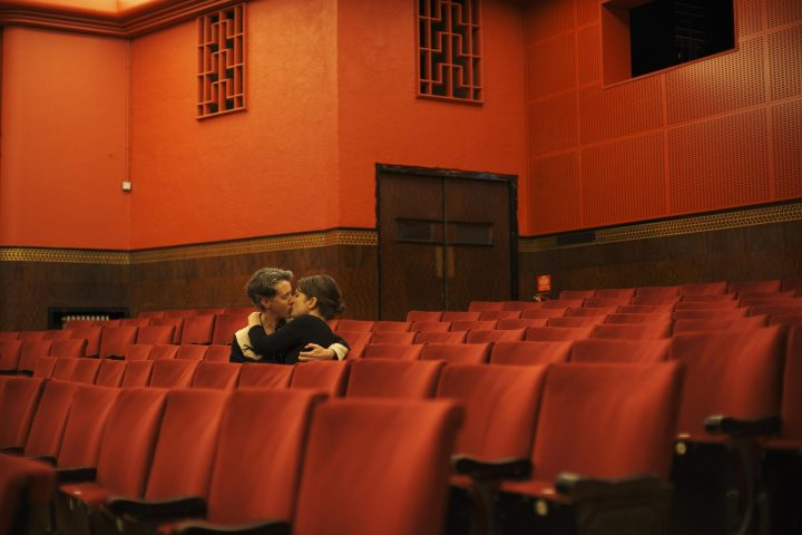 Couple kiss in an empty theatre