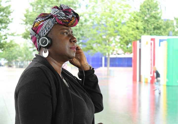 Women in a headscarf and headphones