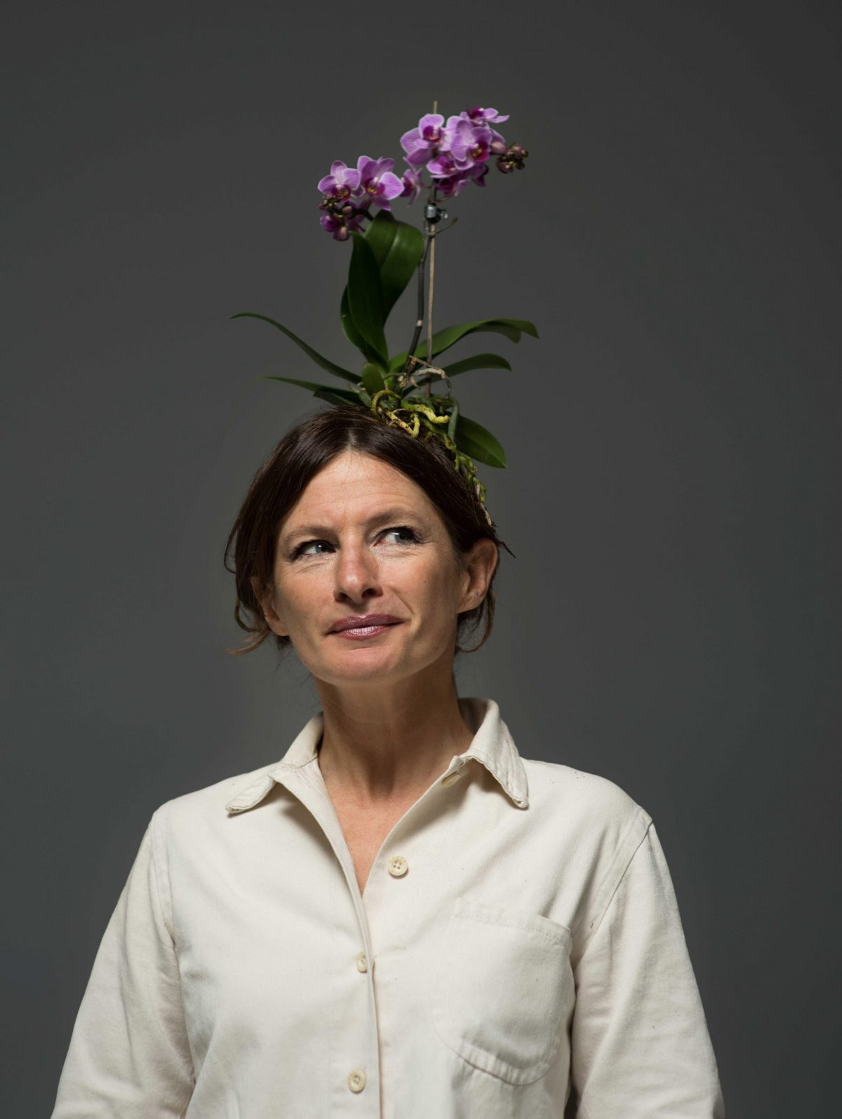 Woman with an elaborate orchid headdress