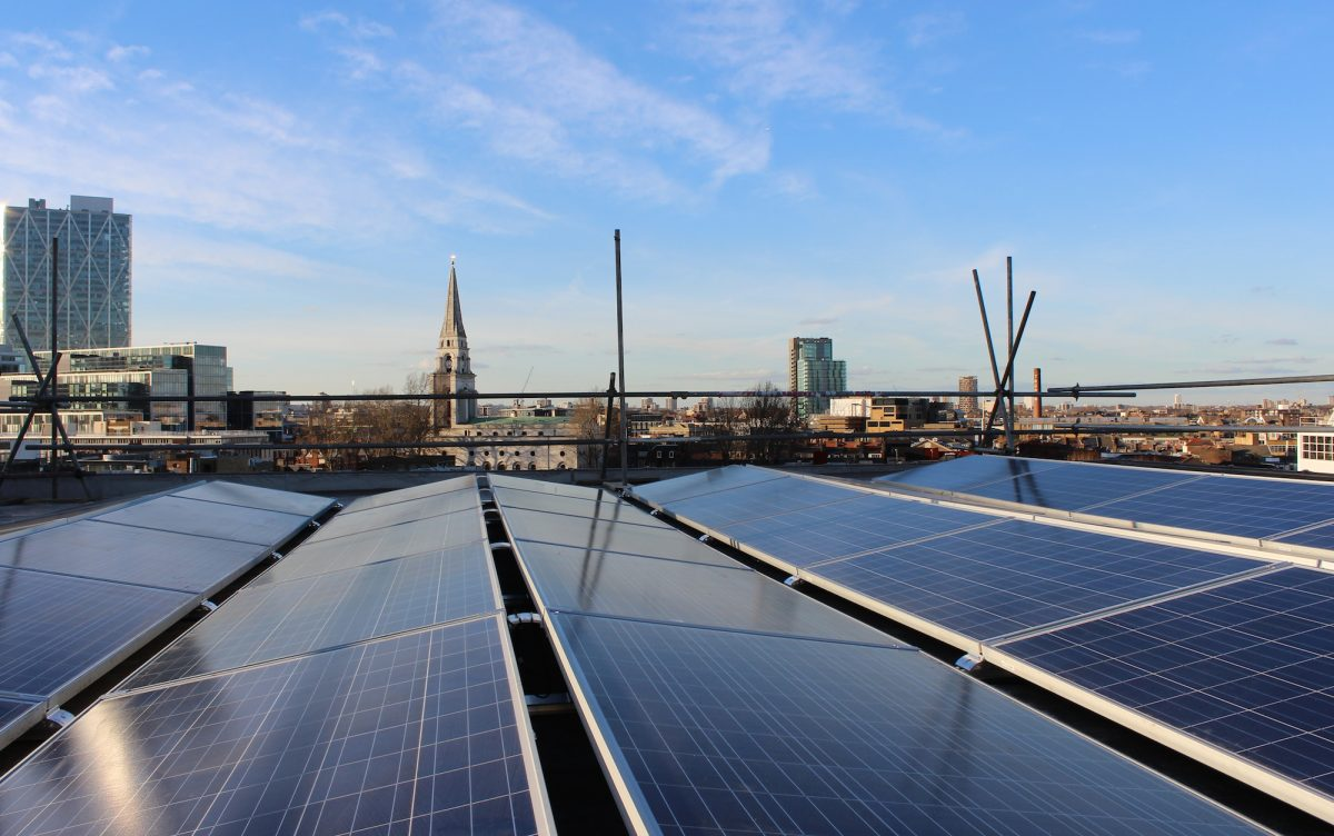 Solar panels on the roof against the city skyline