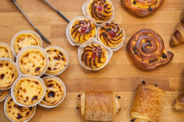 Custard Tarts and pastries on a wooden board