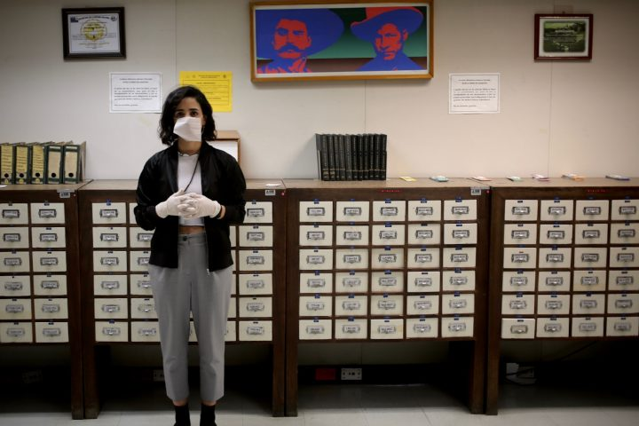 woman standing in front of boxes